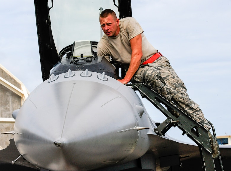 U.S. Air Force Master Sgt. David Custer, Vermont Air National Guard's 158th Maintenance Squadron lead crew chief, services the cockpit of a U.S. Air Force F-16 Fighting Falcon July, 22, 2015, on Kadena Air Base, Japan. Custer has been an ANG Airman for 12 years and has spent 11 of them within the same unit along with some of his peers. The F-16 provides a relatively low-cost, high-performance weapon system for the U.S. and allied nations. (U.S. Air Force photo by Airman 1st Class John Linzmeier)