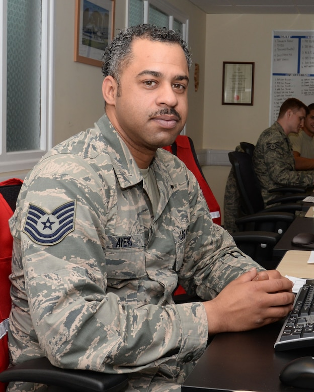 U.S. Air Force Tech. Sgt. Dury Ayers, 100th Logistics Readiness Squadron NCO in charge of deployment operations from Lackland Air Force Base, Texas, poses for a photograph July 21, 2015, on RAF Mildenhall, England. Ayers was nominated for the Square D Spotlight for portraying the core value of Service Before Self. (U.S. Air Force photo by Gina Randall/Released)