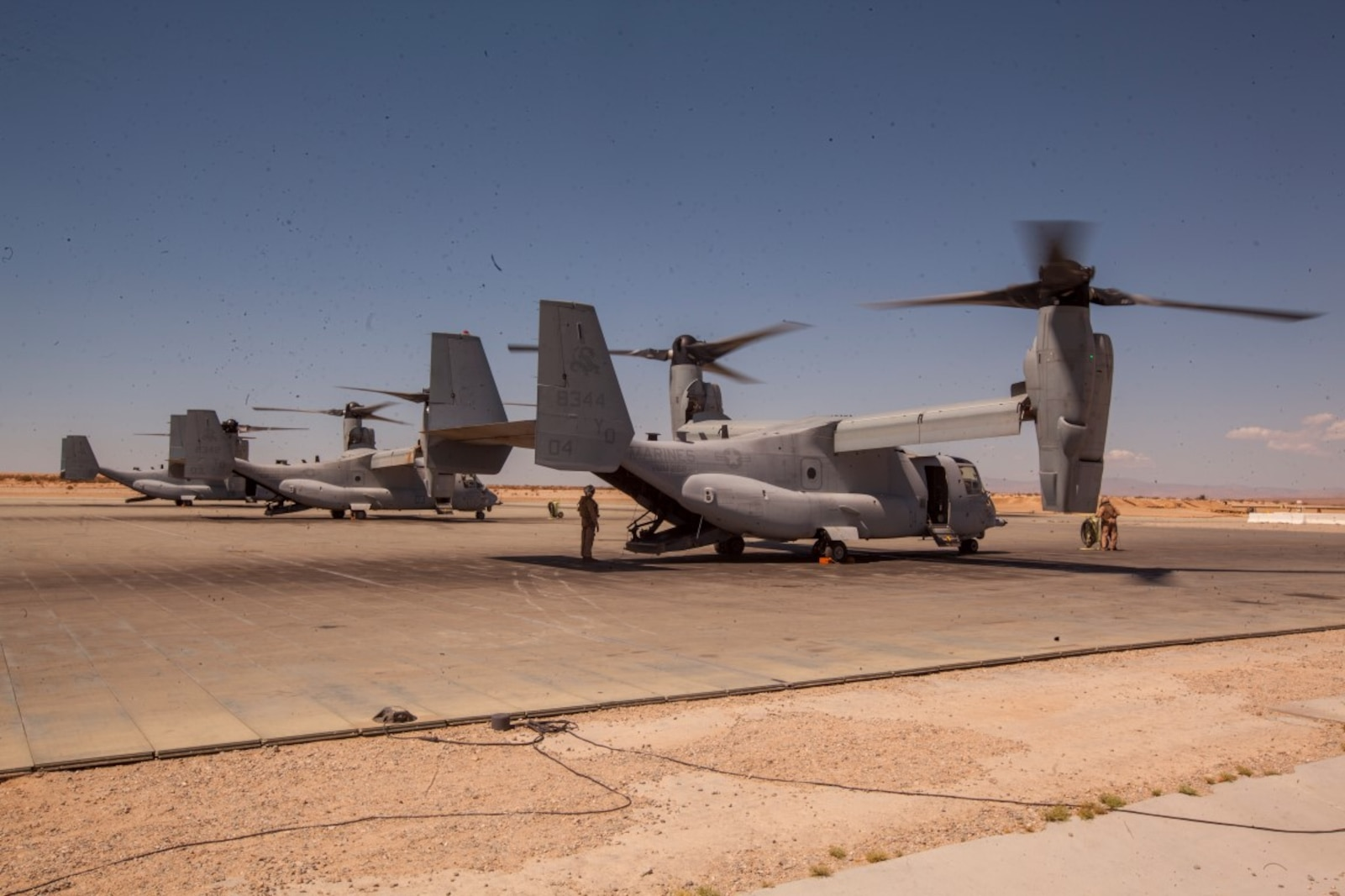 Ospreys with Marine Medium Tiltrotor Squadron 268, Marine Aircraft Group 16, 3rd Marine Aircraft Wing, prepare to depart an expeditionary airfield at Camp Wilson aboard Marine Corps Air Ground Combat Center Twentynine Palms, Calif., July 17, to conduct a tactical recovery of aircraft and personnel mission with 3rd Platoon, C Company, 1st Battalion, 7th Marines, during a certification exercise for Special Purpose Marine Air-Ground Task Force Crisis Response Central Command 16.1. SPMAGTF-CR-CC is a fully capable crisis response unit with the ability to project power over the vast distances using organic air and ground combat assets.
