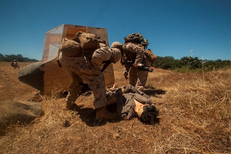 Infantry Marines with 3rd Platoon, Company C, 1st Battalion, 7th Marines, locate and assess a simulated victim near landing zone K Springs aboard Marine Corps Base Camp Pendleton, Calif., July 17, while conducting a tactical recovery of aircraft and personnel mission during a certification exercise for Special Purpose Marine Air-Ground Task Force Crisis Response Central Command 16.1. SPMAGTF-CR-CC is a fully capable crisis response unit with the ability to project power over the vast distances using organic air and ground combat assets.