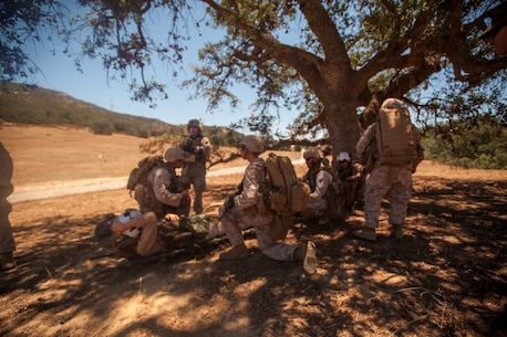Infantry Marines with 3rd Platoon, Company C, 1st Battalion, 7th Marines, provide security for a simulated victim at landing zone K Springs aboard Marine Corps Base Camp Pendleton, Calif., July 17, while awaiting pick up from a tactical recovery of aircraft and personnel mission during a certification exercise for Special Purpose Marine Air-Ground Task Force Crisis Response Central Command 16.1. SPMAGTF-CR-CC is a fully capable crisis response unit with the ability to project power over the vast distances using organic air and ground combat assets.