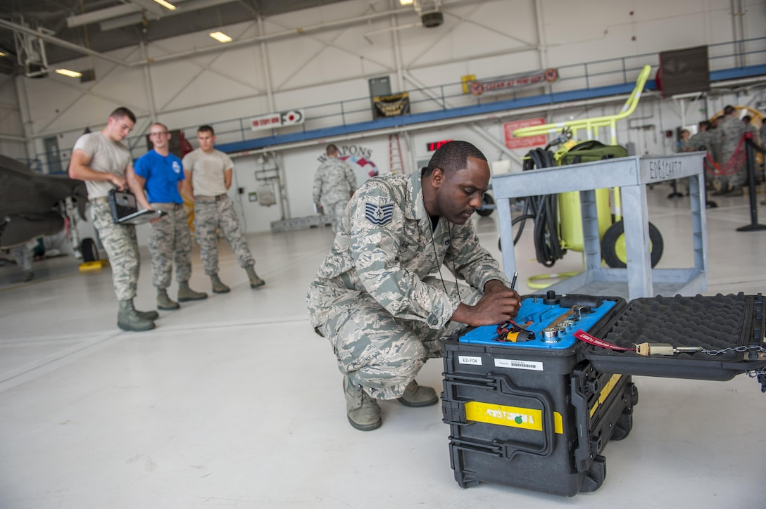 Tech. Sgt. Daryl Crane, 33rd Maintenance Group F-35A Lightning II loading standardization crew member, inspects a tool kit during a weapons load competition on Eglin Air Force Base, Fla., July 10, 2015. During weapons load competitions, crews are evaluated on a uniform inspection, a written test, a quality assurance inspection of the teams' tool kits and how safely, efficiently and timely they load munitions on an F-35A. (U.S. Air Force Photo/Staff Sgt. Marleah Robertson)
