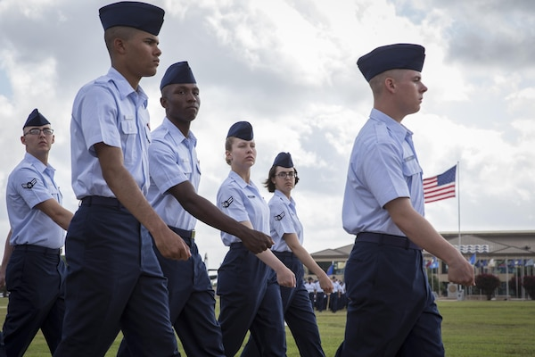 For the first time in Air Force Basic Military Training, Airmen march in integrated Heritage Flights during the Air Force Basic Training Graduation Parade July 17 at Joint Base San Antonio-Lackland. The Heritage flights, named after enlisted members in Air Force history, are part of a new initiative to completely gender integrate all facets of Air Force Basic Training and instill honor, as well as a deep understanding of the core values and appreciation for Airmen who paved the way for today's Air Force.