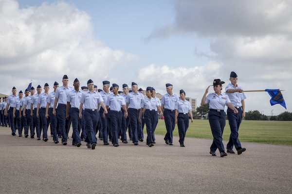 For the first time in Air Force Basic Military Training, Airmen march in integrated Heritage Flights during the Air Force Basic Training Graduation Parade July 17 at Joint Base San Antonio-Lackland. The Heritage flights, named after enlisted members in Air Force history, are part of a new initiative to completely gender integrate all facets of Air Force Basic Training and instill honor, as well as a deep understanding of the core values and appreciation for Airmen who paved the way for today's Air Force. (U.S. Air Force photo by Joshua Rodriguez) (released)
