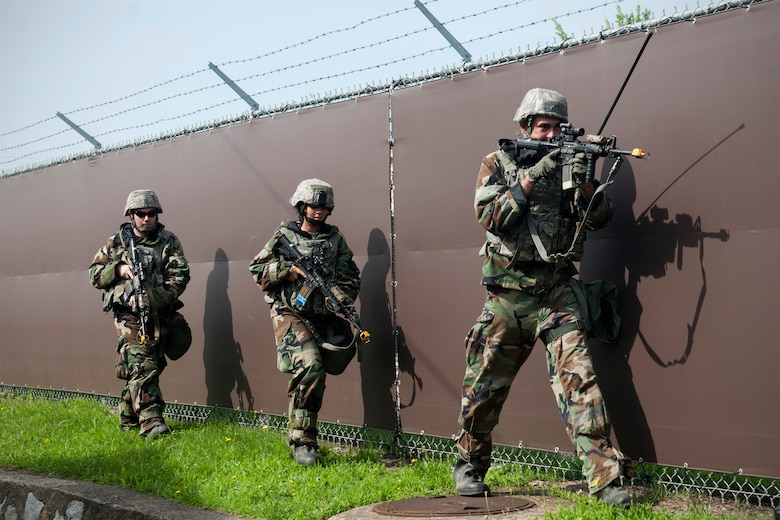 U.S. Air Force Airmen from the 8th Security Forces Squadron conduct perimeter security following a simulated ground attack during Exercise Beverly Midnight 15-4 at Kunsan Air Base, Republic of Korea, July 16, 2015. Combat Airmen reacted, survived and operated in a simulated combat zone to validate and enhance Kunsan's mission to defend the base and take the fight north during the five-day operational readiness exercise. (U.S. Air Force photo by Senior Airman Katrina Heikkinen/Released)
