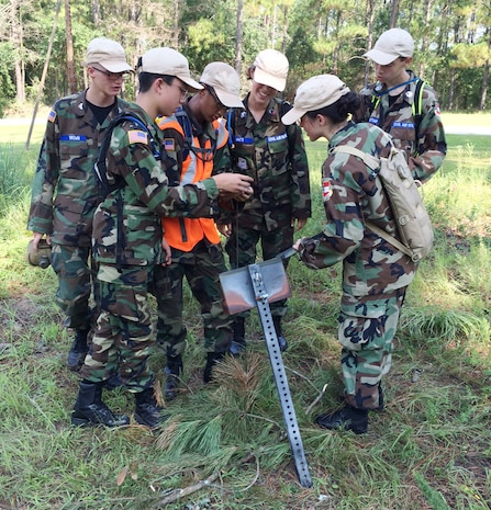 Georgia Wing Civil Air Patrol cadets collaborate before setting out for their next objective during land navigation training, July 22. This is the fourth year the Georgia Wing CAP has conducted its weeklong summer encampment at Marine Corps Logistics Base Albany.