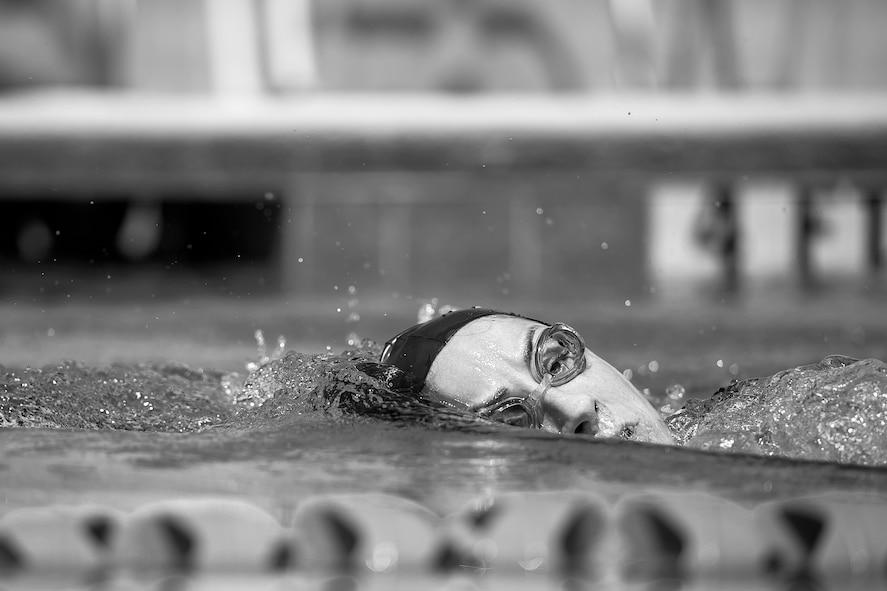 U.S. Air Force 1st Lt. Morgan K. Diglia, Sexual Assault Response Coordinator deputy, surfaces for air while swimming at the McGarr Pool on Goodfellow Air Force Base, Texas, July 24, 2015. Diglia is prepping for an olympic triathlon, which includes a 1.5km swim, 40km bike ride, and a 10km run. (U.S. Air Force photo by Staff Sgt. Michael Smith/Released)
