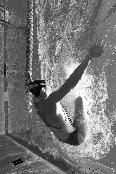 U.S. Air Force 1st Lt. Morgan K. Diglia, Sexual Assault Response Coordinator deputy, performs a flip-turn while swimming at the McGarr Pool on Goodfellow Air Force Base, Texas, July 24, 2015. Diglia is preparing for an upcoming olympic triathlon. (U.S. Air Force photo by Staff Sgt. Michael Smith/Released)