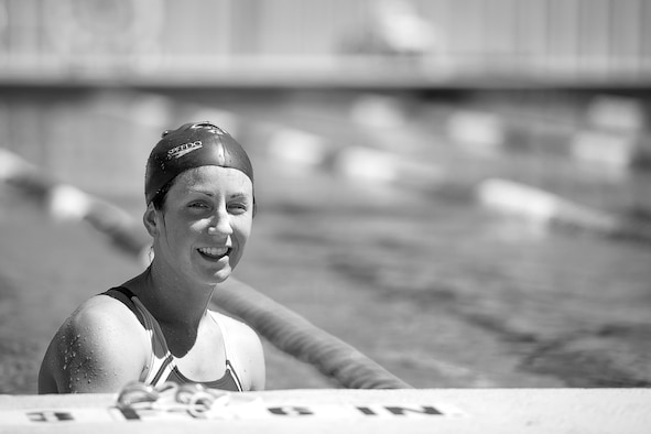 U.S. Air Force 1st Lt. Morgan K. Diglia, Sexual Assault Response Coordinator deputy, takes a break while swimming at McGarr Pool on Goodfellow Air Force Base, Texas, July 24, 2015. Diglia is preparing for an upcoming olympic triathlon. (U.S. Air Force photo by Staff Sgt. Michael Smith/Released)