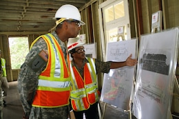 FORT SHAFTER, Hawaii (July 24, 2015) --  U.S. Army Pacific Commander Gen. Vincent K. Brooks looks at an historic photo of Fort Shafter's Bldg. T-112 taken circa. 1910 during a briefing about the building's rehabilitation project from Honolulu District Supervisory Engineer Steve Yamamoto. Building T-112, built in 1907 and also known as Dunning Hall, is an important structure that is a key part of the Palm Circle National Historic Landmark District.