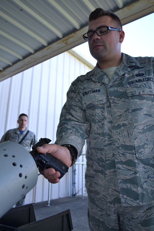 "2nd Lt. Dakota Kauffman, 270th Engineering Installation Squadron project engineer, clears his pistol in preparation for transport of the 111th Attack Wing's marksmanship team to the Governor's Twenty competition. The top 20 competitors are awarded embroidered emblems and certificates distinguishing them as being a member of ""The Governor's Twenty"" during this annual National Guard-wide event. (U.S. Air National Guard photo by Tech. Sgt. Andria Allmond/Released)"