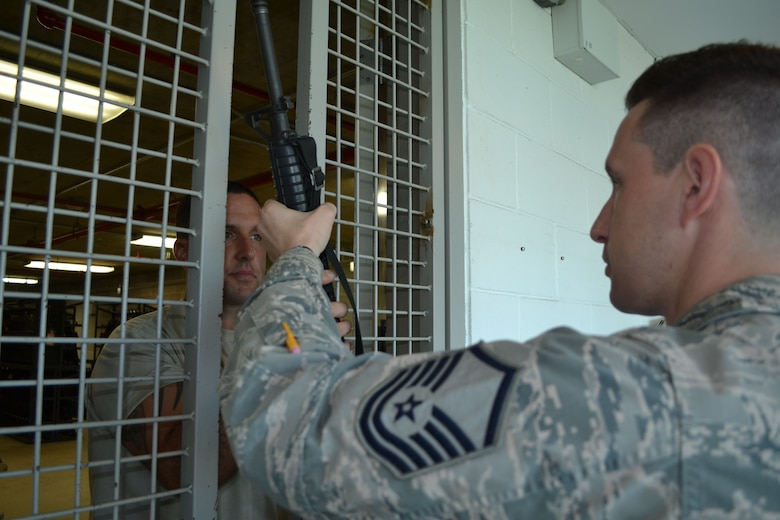 Master Sgt. Joe Sommers, 111th Logistics Readiness Squadron material management flight chief, issues a rifle to Master Sgt. John Riccio, 103rd Attack Squadron non-commissioned officer in charge of standardization and evaluation, July 24, 2015, at the Horsham Air Guard Station armory, Horsham, Pennsylvania. RIccio is a member of the 111th Attack Wing's marksmanship team and is one of only two wing members permitted to sign out and transport weapons for the team. (U.S. Air National Guard photo by Tech. Sgt. Andria Allmond/Released)