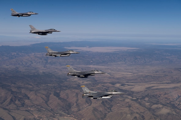 Five Arizona Air National Guard F-16 Fighting Falcons soar over the Arizona desert during a training mission. Guardsmen based at the Tucson International Airport carry out a full-time mission to train U.S. and partner-nation fighter pilots. (U.S. Air Force photo/ Master Sgt. Jeffrey Allen/Released)