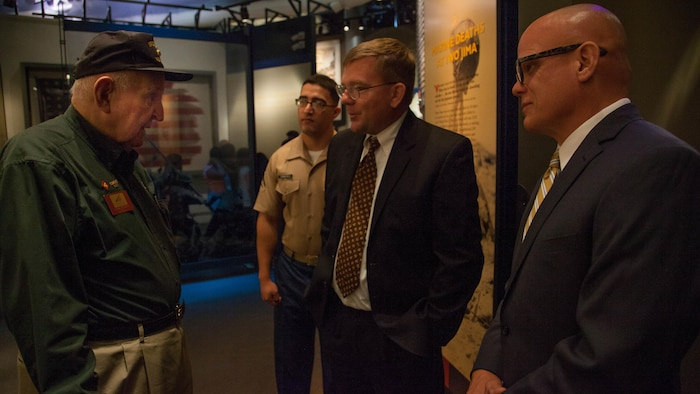 Mark Noah, center, the executive director of History Flight, speaks with Frank Matthews, left, a veteran of the Battle of Iwo Jima, before receiving the title of Honorary Marine during a ceremony held at the National Marine Corps Museum, at Triangle, Virginia, July 24. History flight has recovered the remains of several hundred Marines and sailors deemed unrecoverable at the conclusion of Battle of Tarwa.