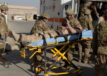 U.S. Air Force medical personnel care for a simulated injured patient during a base wide training exercise July 24, 2015, at Bagram Airfield, Afghanistan. The base conducts regular training exercises that include scenarios ranging from active shooter and indirect fire attacks to mass casualties. (U.S. Air Force photo by Senior Airman Cierra Presentado/Released)