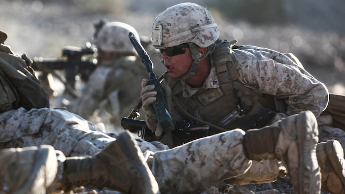 Lance Cpl. Steven Hoggand, a machine gunner and section leader with 1st Platoon, Company C, 1st Battalion, 7th Marines, directs his Marines' fire while suppressing an enemy position during platoon attack drills, July 24, aboard Marine Corps Air Ground Combat Center Twentynine Palms, Calif. Training began for the Marines of Company C with a combined arms fire and maneuver exercise as part of their Integrated Training Exercise in preparation for their upcoming deployment with Special Purpose Marine Air Ground Task Force Crisis Response Central Command 16.1 scheduled to depart later this year.