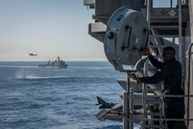 160415-N-MD297-038 PACIFIC OCEAN (April 16, 2015) – Master-at-Arms 2nd Class Roderick Payne aims a Long Rang Acoustic Device (LRAD) at an incoming small craft during a Straits Transit exercise aboard Wasp-class amphibious assault ship USS Essex (LHD 2). Essex is underway participating in a certification exercise (CERTEX) with the Essex Amphibious Ready Group (ARG), which is comprised of amphibious Squadron (PHIBRON) THREE and 15th Marine Expeditionary Unit (MEU). (U.S. Navy photo by Mass Communication Specialist 3rd Class Huey D. Younger Jr./Released)