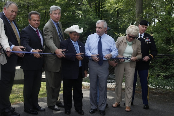 Col. Christopher Barron, District Commander, joins partners in cutting the ribbon on the successful Ten Mile River Restoration Project on June 19, 2015.