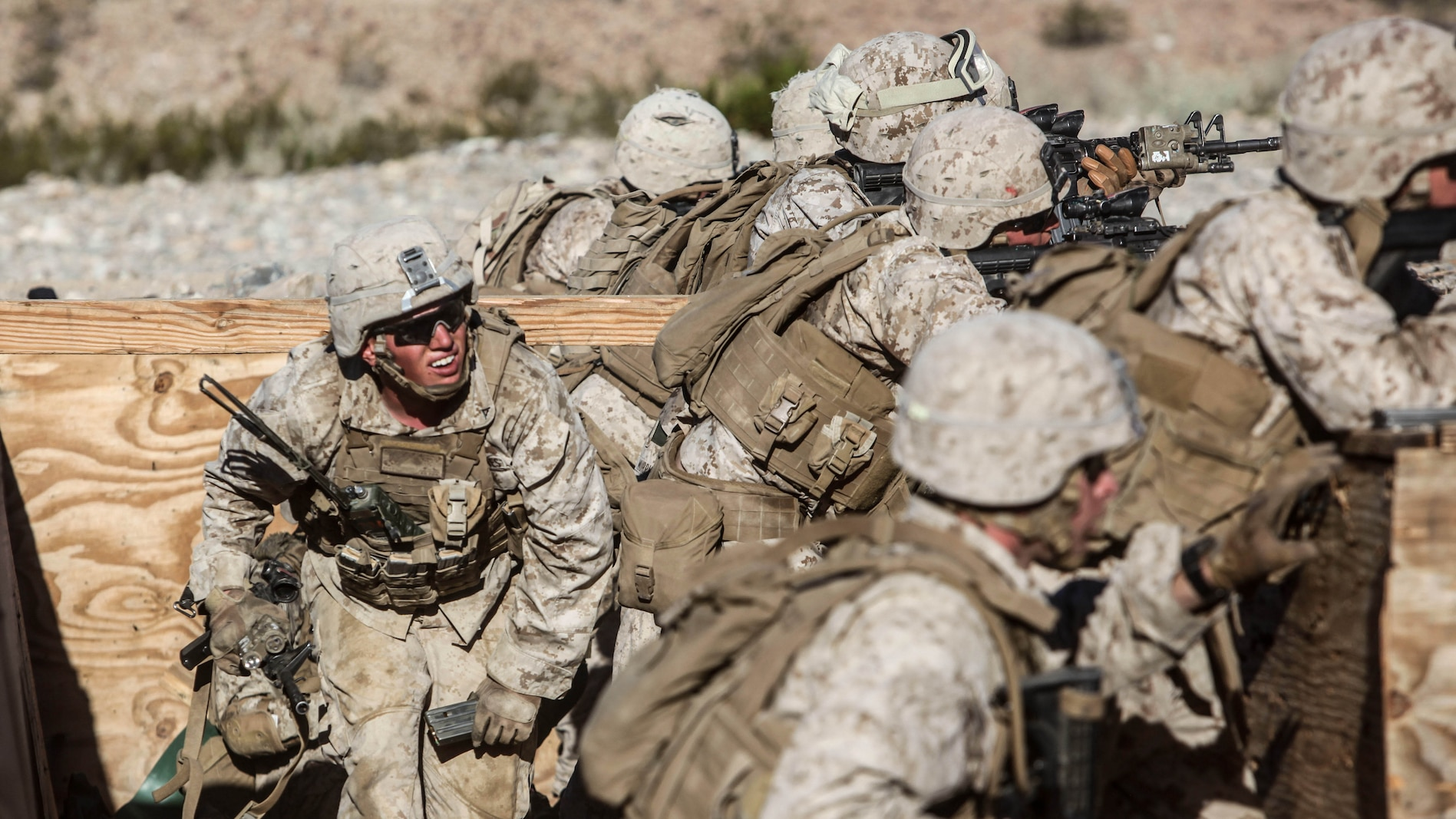 A Marine with 1st Platoon, Company C, 1st Battalion, 7th Marines, runs along his squad's firing line distributing ammunition during platoon attack drills, July 24, aboard Marine Corps Air Ground Combat Center Twentynine Palms, Calif. Training began for the Marines of Company C with a combined arms fire and maneuver exercise as part of their Integrated Training Exercise in preparation for their upcoming deployment with Special Purpose Marine Air Ground Task Force Crisis Response Central Command 16.1 scheduled to depart later this year.