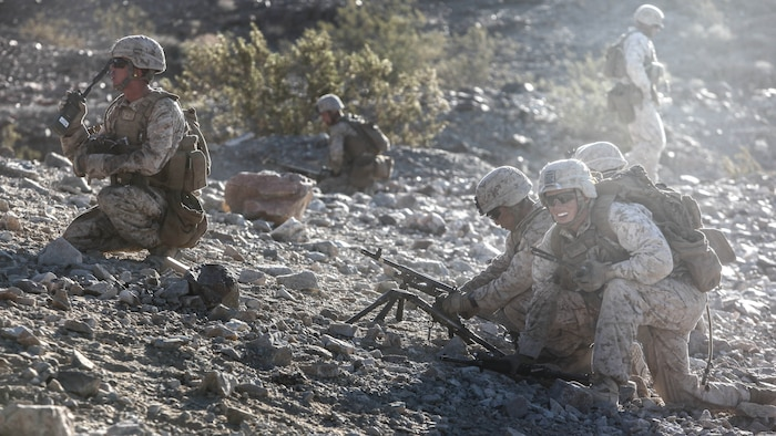 A medium machine gun team with 1st Platoon, Company C, 1st Battalion, 7th Marines, prepares to advance to their support by fire position during platoon attack drills, July 24, aboard Marine Corps Air Ground Combat Center Twentynine Palms, Calif. Training began for the Marines of Company C with a combined arms fire and maneuver exercise as part of their Integrated Training Exercise in preparation for their upcoming deployment with Special Purpose Marine Air Ground Task Force Crisis Response Central Command 16.1 scheduled to depart later this year.