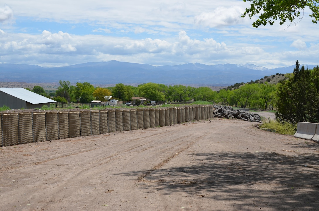 Sediment-filled Hesco baskets line the Santa Clara Creek channel to increase the height of the bank and help contain some flood flows. Courtesy Elizabeth Lockyear/U.S. Army Corps of Engineers, Albuquerque District