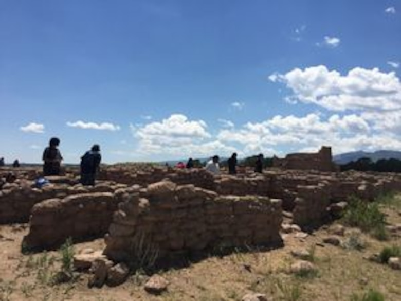 As Climate Changes, Santa Clara Strives To Become Resilient To Worsening Fires, Floods: Members of the Santa Clara Pueblo Youth Conservation Corps help preserve ancestral Tewa buildings atop a mesa that overlooks the flood-scoured Santa Clara Creek bed. Pueblo residents' ancestors used to hike miles down the mesa for water, said pueblo Gov. Michael Chavarria. 'We're not financially wealthy. We're wealthy with our culture, language and traditions.' Margaret Wright/The New Mexican
