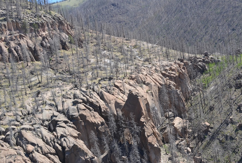 As Climate Changes, Santa Clara Strives To Become Resilient To Worsening Fires, Floods: Part of the Las Conchas Fire burn scar in the Santa Clara Canyon area, as viewed from from a helicopter tour on June 4. Courtesy Elizabeth Lockyear/U.S. Army Corps of Engineers, Albuquerque District