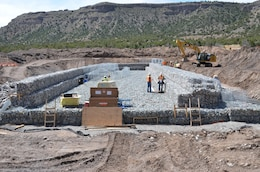As Climate Changes, Santa Clara Strives To Become Resilient To Worsening Fires, Floods: Two gabion check structures are being built upstream of the village of Santa Clara Pueblo in the lower Santa Clara Canyon. The rock-filled basket structures, designed to slow flood flows and catch debris and sediment, range between 350 feet and 450 feet in length and are less than 25 feet above grade. Courtesy Elizabeth Lockyear/U.S. Army Corps of Engineers, Albuquerque District