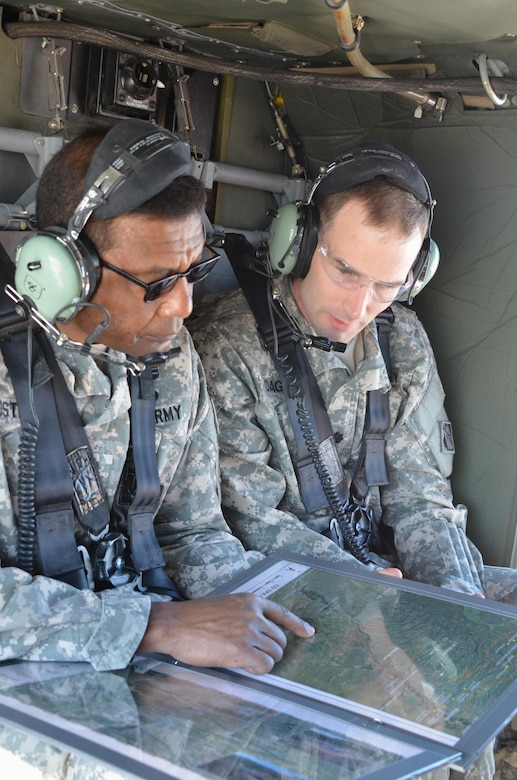 As Climate Changes, Santa Clara Strives To Become Resilient To Worsening Fires, Floods: Lt. Gen. Thomas Bostick, left, and Albuquerque District Commander Lt. Col. Patrick Dagon of the U.S. Army Corps of Engineers examine a map detailing the route of a helicopter tour June 4, to view work being done to protect Santa Clara Pueblo from increased flood risks caused by the 2011 Las Conchas Fire. Courtesy Elizabeth Lockyear/U.S. Army Corps of Engineers, Albuquerque District
