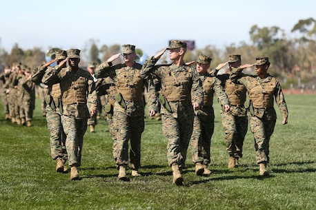 "U.S. Marines with Headquarters and Headquarters Squadron (H&HS) conduct a pass in review during the H&HS Relief and Appointment Ceremony aboard Marine Corps Air Station Miramar San Diego, Calif., on March 5, 2014. The Relief and Appointment signifies the ""passing of responsibility"" from one senior enlisted advisor to another.(U.S. Marine Corps photo by Cpl. Daniel V. Gonzales/RELEASED)"