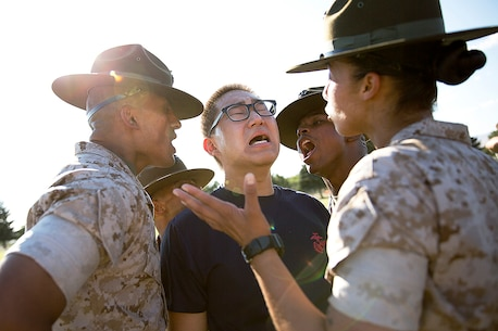 Seung Gwon Cho (center), a Marine enlistee from Lynnwood, Wash., responds to corrections from drill instructors Sgts. Aldo Valencia (left), Julian Taylor (second from left), Donald Jackson (second from right) and Tina Quevedo (right) during a Recruiting Station Seattle pool function at the Yakima Training Center in Yakima, Wash., July 17, 2015. During the event, recruiters teamed with drill instructors to physically and mentally prepare enlistees from Washington and Idaho for boot camp. The enlistees, part of the Marine Corps delayed entry program, are awaiting their ship dates. Cho, 18, graduated from Meadowdale High School and was recruited by Sgt. Ricardo Schebesta. Valencia, 25, is from Denver and is assigned to Delta Company, 1st Recruit Training Battalion. Taylor, 26, is from St. Augustine, Fla., and is assigned to Lima Company, 3rd Recruit Training Battalion. Jackson, 28, is from Suffolk, Va., and is assigned to MCRD San Diego. Quevedo, 24, is from Long Beach, Calif., and is currently assigned to November Company, 4th Recruit Training Battalion. (U.S Marine Corps photo by Sgt. Reece Lodder)
