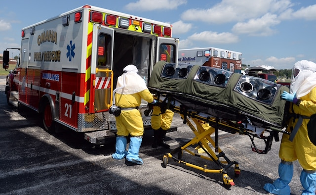 Members of the Omaha Fire and Rescue Department load a simulated patient into an ambulance during exercise Patriot 15, at Offutt Air Force Base, Neb., July 23, 2015. The exercise is a domestic operation disaster-response training exercise conducted by National Guard units working with federal, state and local emergency management agencies and first responders. (U.S. Air Force photo/Tech. Sgt. Nathan Lipscomb)