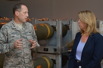 Secretary of the Air Force Deborah Lee James talks with Lt. Gen. Lee K. Levy II, the Air Force Sustainment Center commander, about Standard Air Munitions Package (STAMP) issues during her visit to Hill Air Force Base, Utah, July 23, 2015. STAMP is a munitions package meant to resupply warfighters. (U.S. Air Force photo/Alex R. Lloyd)