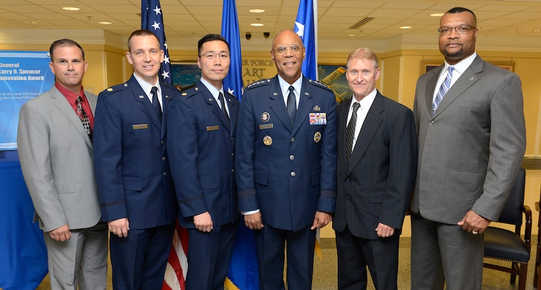The 2014 individual and team winners of the inaugural General Larry O. Spencer Innovation Award stand with Spencer, the Air Force vice chief of staff, after a ceremony at the Pentagon July 23, 2015. They are, from left to right, Andrew L. Sloper, Maj. Perry J. Johns, Maj. Anthony Ty, Spencer, Frederick Suedbeck and Anthony McCray.  The award was created by Air Force Chief of Staff Gen. Mark A. Welsh III to recognize Airmen who share their creative and efficient ways to save money and time. (U.S. Air Force photo/Scott M. Ash)