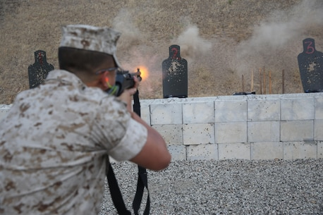Pfc. Caston Mai, an administrative clerk with Headquarters and Headquarters Squadron and an Arlington, Texas, native, shoots the M1014 shotgun during security augment force (SAF) training aboard Marine Corps Air Station Miramar, California, June 30. During the course, trainees learn arrest techniques and defensive tactics. (Official U.S. Marine Corps photo by Lance Cpl. Kimberlyn Adams/Released)