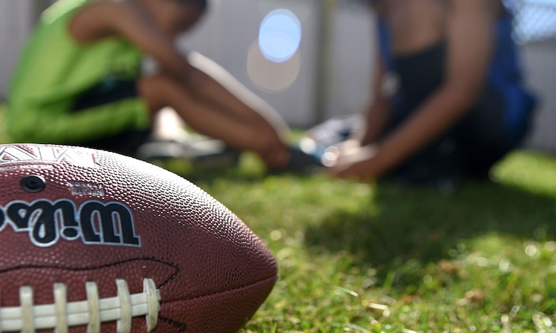 Summer is one of the most dangerous seasons for sports injuries. Children and adults should properly prepare for and ease into summer sports such as football to prevent injuries. Summer sports safety can be narrowed down to three essentials points: hydration, stretching and conditioning, and the wear of proper gear. (U.S. Air Force photo/Staff Sgt. Sheila deVera)
