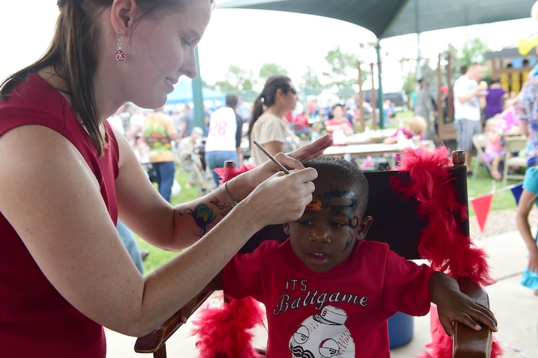 A child gets his face painted during FunFest July 24, 2015, at Buckley Air Force Base, Colo. FunFest is an annual base-wide event that includes family-friendly games and activities, community involvement and local business sponsors. (U.S. Air Force photo by Airman 1st Class Luke W. Nowakowski/Released)