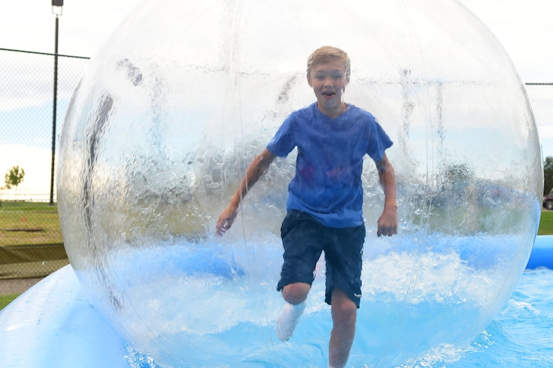 """A boy """"runs on water"""" during FunFest July 24, 2015, at Buckley Air Force Base, Colo. FunFest is an annual base-wide event that includes family-friendly games and activities, community involvement and local business sponsors. (U.S. Air Force photo by Airman 1st Class Luke W. Nowakowski/Released)"""