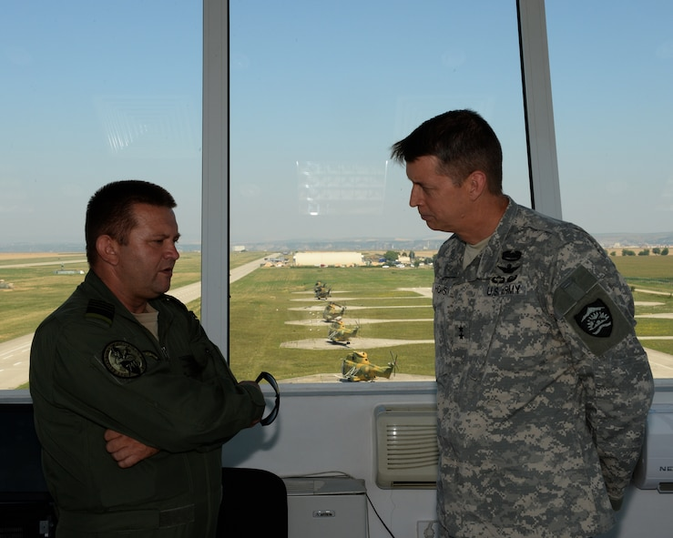 U.S. National Guard Maj. Gen. Daniel Hokanson, Oregon National Guard Adjutant General, right, speaks with Romanian air force Cmdr. Marius Oatu, 71st Air Base commander, during a base tour at Campia Turzii, Romania, July 22, 2015. Hokanson received a tour of the base by Oatu before visiting with Airmen of the 123rd Expeditionary Fighter Squadron. Twelve F-15C Eagles deployed to Romania as part of a European theater security package. (U.S. Air Force Senior Airman Dylan Nuckolls/Released)