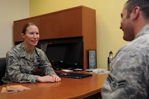 Master Sgt. Sally Ford speaks with an Airman at the Air National Guard Readiness Center on Joint Base Andrews, Md., June 10, 2015. Ford is the 2015 Air National Guard Outstanding First Sergeant of the Year. (Air National Guard photo by Master Sgt. David Eichaker/released)