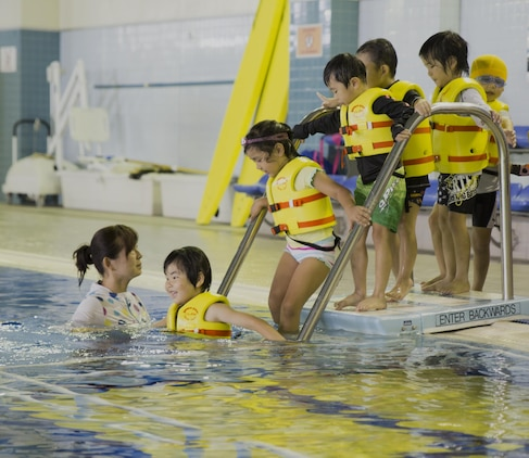 Students from Kawashimo Yochien in Iwakuni City, celebrate their last day at the IronWorks pool aboard Marine Corps Air Station Iwakuni, Japan, July 21, 2015. Coming to the station pool is an honor unique to the senior kindergarten class and is a 30-year tradition.