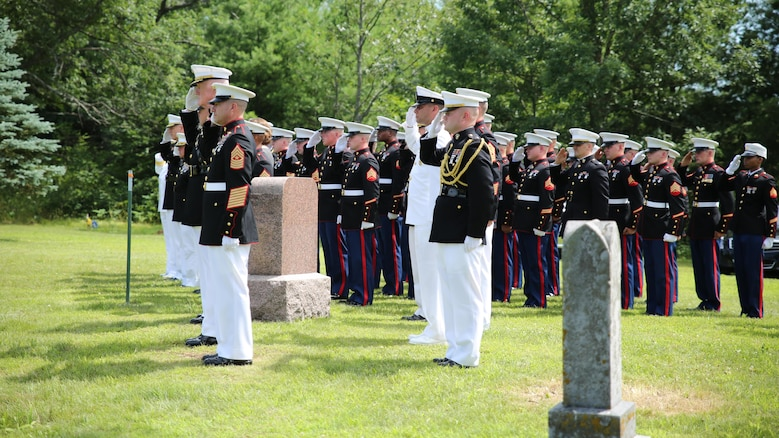Lt. Gen. Richard P. Mills, commander of Marine Forces Reserve, and Marines of and sailors of Marine Forces Reserve, salute as TAPS is played for Sgt. Carson Holmquist, a motor transport maintenance chief with and Battery M, 3rd Battalion, 14th Marine Regiment, 4th Marine Division, Marine Forces Reserve, during his funeral July 25, 2015 in Grantsburg, Wisconsin Holmquist, along with three other Marines and a sailor, was killed in an attack at the Naval Operation Support Center and Marine Corps Reserve Center in Chattanooga, Tennessee July 16, 2015. Marines, family, friends and the community of Grantsburg gathered to honor the memory and sacrifice of Holmquist and his fallen brothers-in-arms.