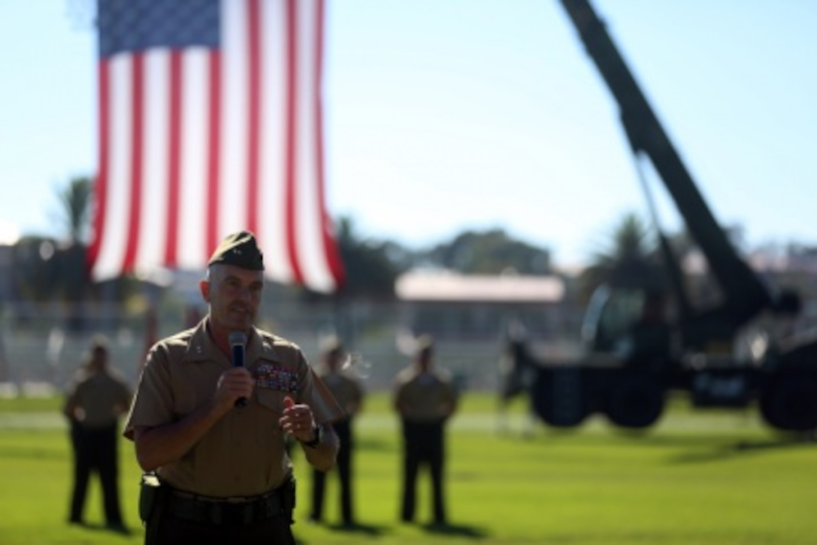 U.S. Marine Maj. General Vincent A. Coglinese, 1st Marine Logistics Group (1st MLG), speaks to Marines, Sailors, family, and friends who attended the 1st Marine Logistics Group Change of Command Ceremony aboard Camp Pendleton, Calif., July 24, 2015. The Change of Command for 1st MLG showcased the passing of command from Maj. Gen. Vincent A. Coglinese to Brig. Gen. David a Ottignon. (U.S. Marine Corps photo by Cpl. Rodion Zabolotniy/Released)