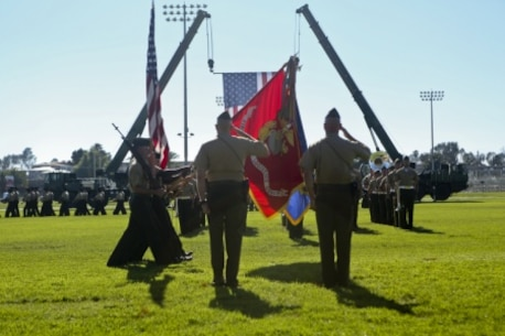U.S. Marine Maj. General Vincent A. Coglinese, 1st Marine Logistics Group (1st MLG), and Brig. Gen. David A Ottignon render honors to colors during the pass in review of the 1st Marine Logistics Group Change of Command Ceremony aboard Camp Pendleton, Calif., July 24, 2015. The Change of Command for 1st MLG showcased the passing of command from Maj. Gen. Vincent A. Coglinese to Brig. Gen. David a Ottignon. (U.S. Marine Corps photo by Lance Cpl. Lauren Falk/Released)