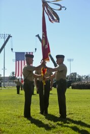 U.S. Marine Maj. General Vincent A. Coglinese, 1st Marine Logistics Group (1st MLG), passes the Group Colors to Brig. Gen. David A Ottignon during the 1st Marine Logistics Group Change of Command Ceremony aboard Camp Pendleton, Calif., July 24, 2015. The Change of Command for 1st MLG showcased the passing of command from Maj. Gen. Vincent A. Coglinese to Brig. Gen. David a Ottignon. (U.S. Marine Corps photo by Lance Cpl. Lauren Falk/Released)