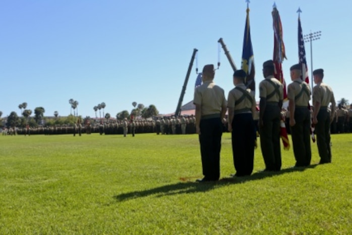 U.S. Marines of 1st Marine Logistics Group take part in the Change of Command Ceremony aboard Camp Pendleton, Calif., July 24, 2015. The Change of Command for 1st MLG showcased the passing of command from Maj. Gen. Vincent A. Coglinese to Brig. Gen. David a Ottignon. (U.S. Marine Corps photo by Lance Cpl. Lauren Falk/Released)