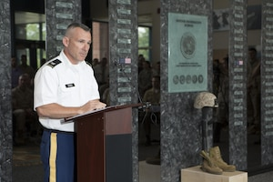 U.S. Army Col. Martin Downie, Defense Information School commandant, speaks during a memorial service and induction ceremony in the Hall of Heroes at DINFOS on Fort George G. Meade, Md., July 27, 2015. The ceremony was in honor of U.S. Marine Corps Cpl. Sara A. Medina and Lance Cpl. Jacob A. Hug, combat photographers who were killed during earthquake relief operations in Nepal, May 12, 2015. (DoD photo by Shane Keller/Released)
