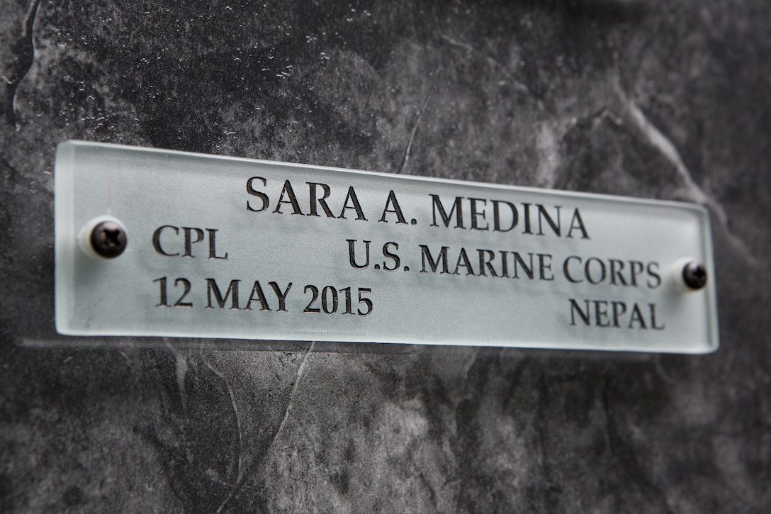 A name placard for U.S. Marine Corps Cpl. Sara A. Medina hangs on a wall in the Hall of Heroes at the Defense Information School on Fort George G. Meade, Md., July 27, 2015. U.S. Marine Corps Cpl. Sara A. Medina and Lance Cpl. Jacob A. Hug, combat photographers, were killed during earthquake relief operations in Nepal, May 12, 2015. (DoD photo by Shane Keller/Released)