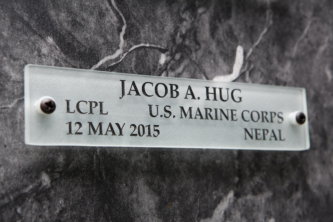 A name placard for U.S. Marine Corps Lance Cpl. Jacob A. Hug hangs on a wall in the Hall of Heroes at the Defense Information School on Fort George G. Meade, Md., July 27, 2015. U.S. Marine Corps Cpl. Sara A. Medina and Lance Cpl. Jacob A. Hug, combat photographers, were killed during earthquake relief operations in Nepal, May 12, 2015. (DoD photo by Shane Keller/Released)