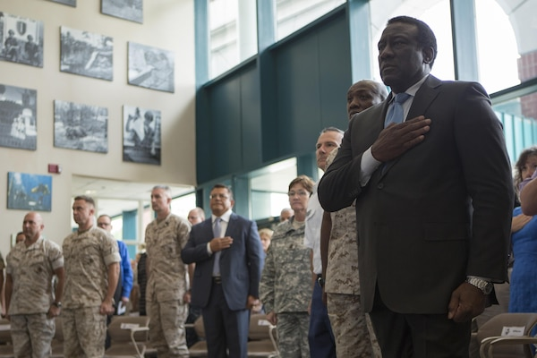 Ray Shepherd, Defense Media Activity director, stands for the national anthem during a memorial service and induction ceremony in the Hall of Heroes at the Defense Information School on Fort George G. Meade, Md., July 27, 2015. The ceremony was in honor of U.S. Marine Corps Cpl. Sara A. Medina and Lance Cpl. Jacob A. Hug, combat photographers who were killed during earthquake relief operations in Nepal, May 12, 2015. (DoD photo by Shane Keller/Released)